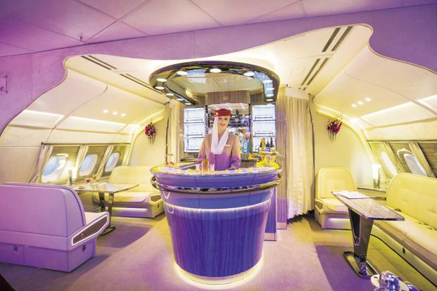 Dubai-based Emirates is giving its flying bars a saloon-style redo. Photo: Bloomberg