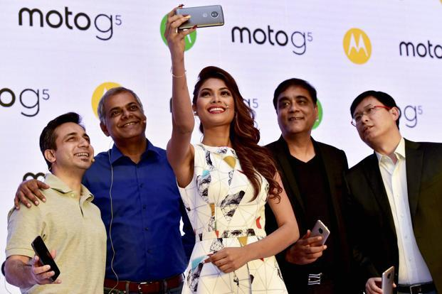 Sudhin Mathur, MD Motorola India (2nd Right), Dillon Ye, VP (Right), Asia Pacific, Lenovo and others pose during the launch of Moto G5 in New Delhi on Tuesday. Photo: PTI