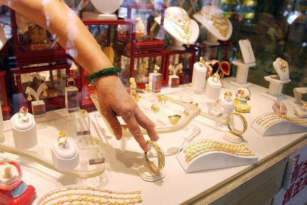 Globally, gold prices fell by 0.13% to $1,253.80 an ounce and silver by 0.25% to $18.22 an ounce in Singapore. Photo: AFP