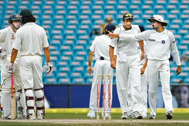 This January 2008 image shows Indian captain Anil Kumble (second right) listening to Harbhajan Singh (right) as Australia's Andrew Symonds (second left) talks with Michael Hussey (left) during the final day of the Sydney Test. Singh was banned by the ICC for three Tests for racial abuses against Symonds. Photo: AFP