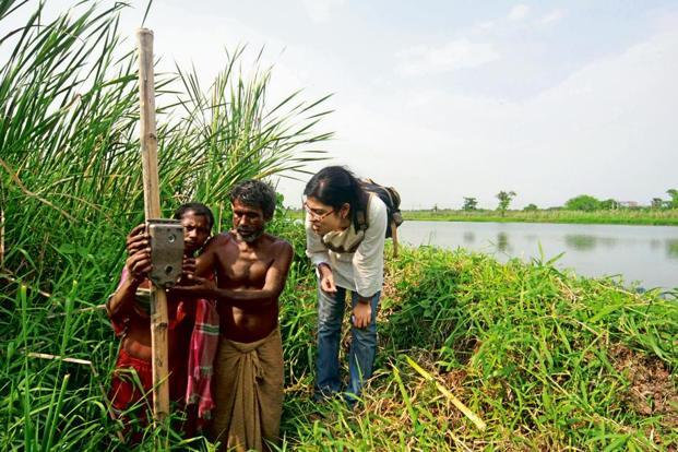 Villagers setting up camera traps. Photo: Partha Dey