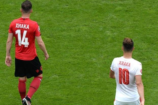 Albania's midfielder Taulant Xhaka (left) with his brother, Switzerland's midfielder Granit, during Euro 2016. Photo: AFP.