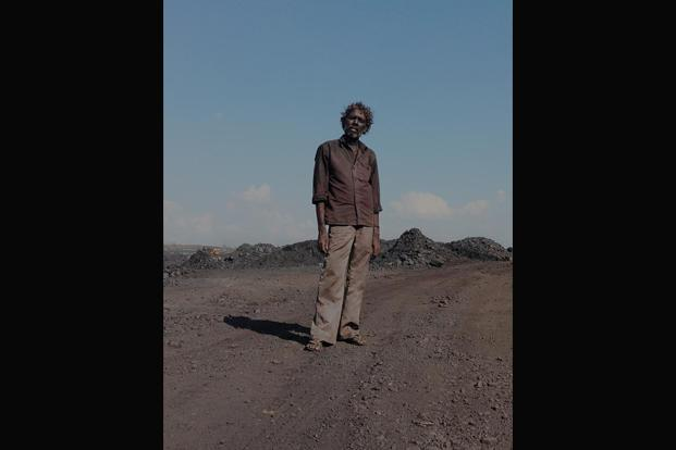 A contractual labour, who makes about Rs200 after loading four or five trucks with coal, at one of Jharia's coal mines.