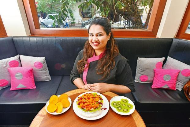 Pooja Dhingra with plates of bright summer foods at the Le15 Café in Colaba. Photo: Aniruddha Chowdhury/Mint