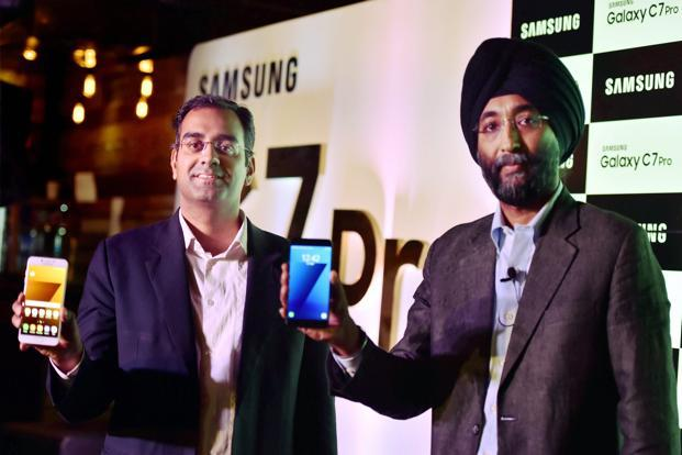 Sandeep Singh Arora, India vice president for online business and Arun Srinivasan, director consumer electronics, Amazon India, during the launch of Galaxy C7 Pro in New Delhi on Friday. Photo: PTI