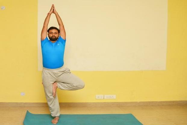 'Vrikshasana': Try maintaining balance by gazing at a stationary point in front of your eyes.