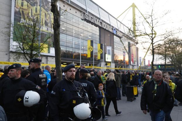 Police patrol outside the stadium after the team bus of Borussia Dortmund had some windows broken by an explosion some 10km away from the stadium prior tothe Champions League match against Monaco. Photo: AFP