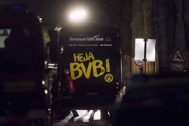 The roadside blasts left Dortmund's Spanish international Marc Bartra and a policeman injured, with the bombs 'containing metal pieces' detonating minutes after the team bus set off to a planned game against Monaco.