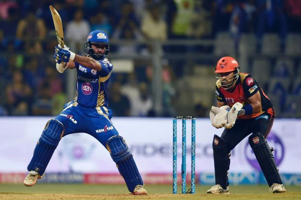 Mumbai Indians cricketer Parthiv Patel (L) playing a shot as Sunrisers Hyderabad cricketer Naman Ojha looks on during the 2017 Indian Premier League (IPL) Twenty20 cricket match at Wankhede Stadium in Mumbai on Wednesday. Photo: AFP