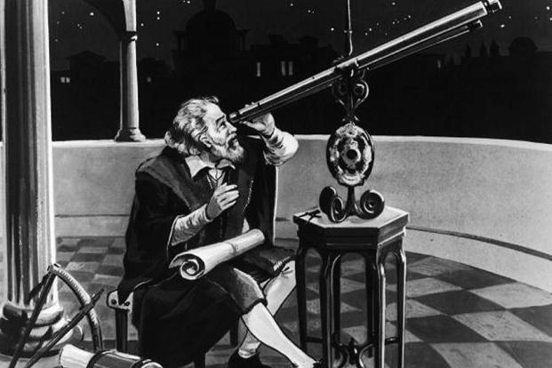 Galileo using a telescope, circa 1620. Photo: Hulton Archive/Getty Images