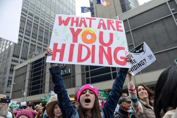 Protesters demanded that Donald Trump should make a disclosure of his tax returns to remove any inkling of conflict of interest between his business and his political decisions. Photo: AFP