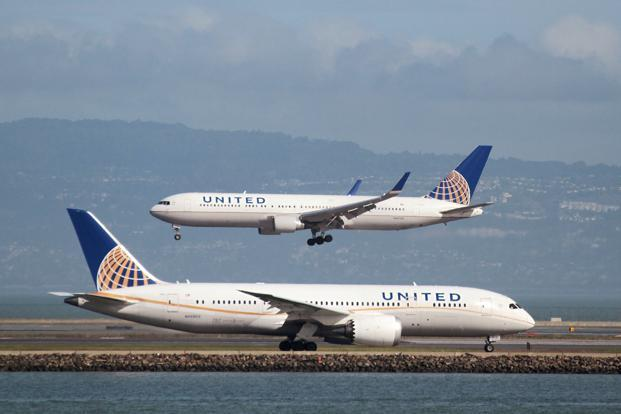 United Airlines's policy change came after the backlash created by a video showing a United passenger being pulled from his seat and dragged down the aisle after refusing to leave an 9 April flight to make room for an airline employee. Photo: Reuters