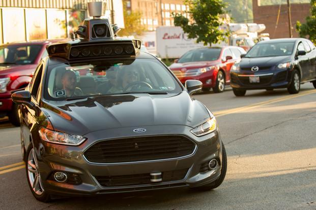 A looming question is what state and federal safety regulators will demand as proof an autonomous car should be given license to roam. Photo: AFP
