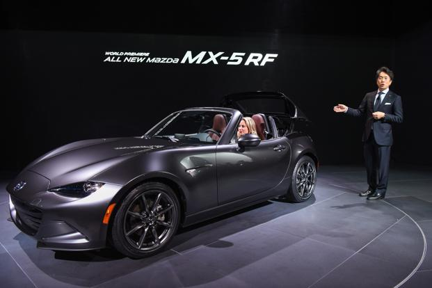 Masahiro Moro, president and CEO of Mazda North America Operations, unveils the Miata MX-5RF convertible vehicle during 2016 New York International Auto Show in New York, US. Photo: Bloomberg