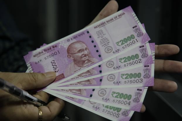 The rupee opened at 64.43 a dollar and touched a high and a low of 64.29 and 64.52, respectively. Photo: AP