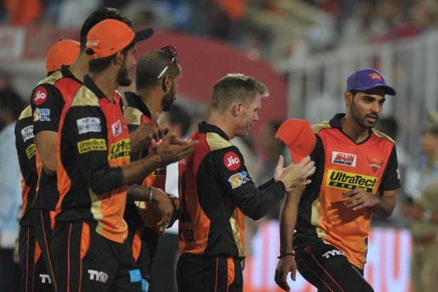 Sunrisers Hyderabad team captain David Warner (L) congratulate Bhuvneshwar Kumar (R) after taking 5 wickets during the 2017 Indian Premier League (IPL) Twenty20 cricket match between Sunrisers Hyderabad and Kings XI Punjab in Hyderabad on Monday. Photo: AFP