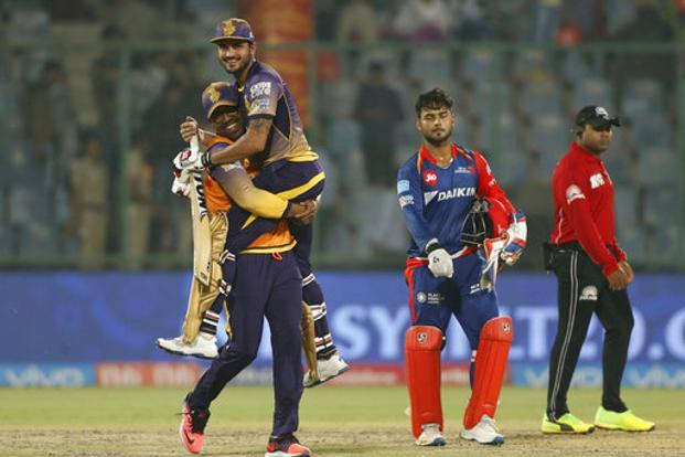 Kolkata Knight Riders' Manish Pandey is lifted by his teammate as they celebrate after winning against Delhi Daredevils during their Indian Premier League (IPL) cricket match in New Delhi on Monday. Photo: AP