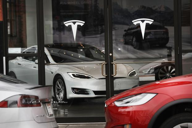 A file photo of Tesla cars displayed in a showroom in New York, US. Leading electric vehicles manufacturers like Tesla and Toyota Motor are evincing interest in the Indian market. Photo: AFP