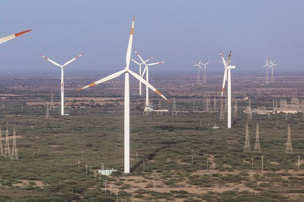 Wind power tariffs have followed the solar route and fell to a record low of Rs3.46 per kWh in a 1GW tender by state-run Solar Energy Corp. of India in February. Photo: Bloomberg
