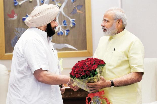 Punjab chief minister Captain Amarinder Singh with Prime Minister Narendra Modi at a meeting in New Delhi on Thursday. Singh sought the PM's support in allowing Punjab to sell its surplus power to Pakistan or Nepal, and encouraging a shift to non-paddy cultivation.  Photo: PTI