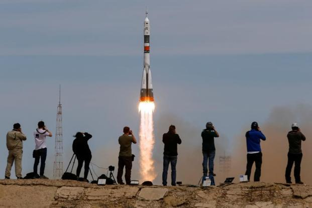 Photographers take pictures as the Soyuz MS-04 spacecraft carrying the crew of Jack Fischer of the US and Fyodor Yurchikhin of Russia blasts off to the ISS from the launchpad at the Baikonur Cosmodrome, Kazakhstan, 20 April 2017. Photo: Reuters