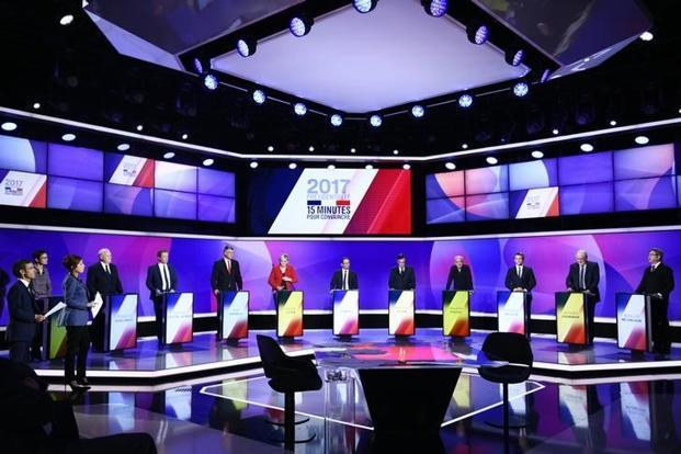 "The eleven French presidential election candidates take part in a special political television show titled ""15min to Convince"" at the studios of French Television channel France 2 in Saint-Cloud, Paris, on Thursday. Photo: Reuters"