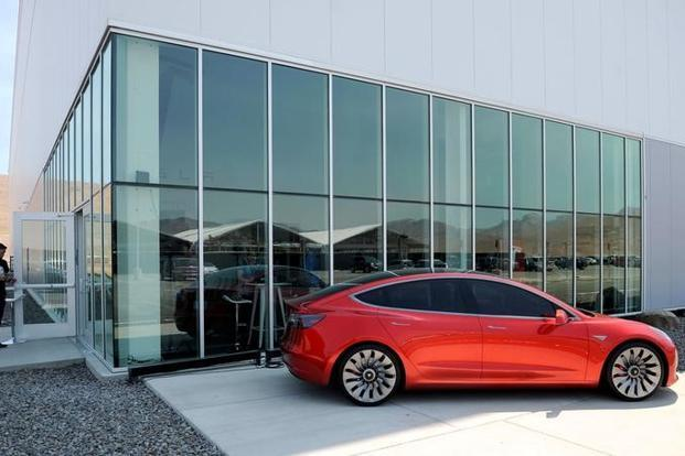 Elon Musk expects the Model 3 rollout to help Telsa deliver five times its current annual sales volume, a key target in the automaker's efforts to stop burning cash. Photo: Reuters