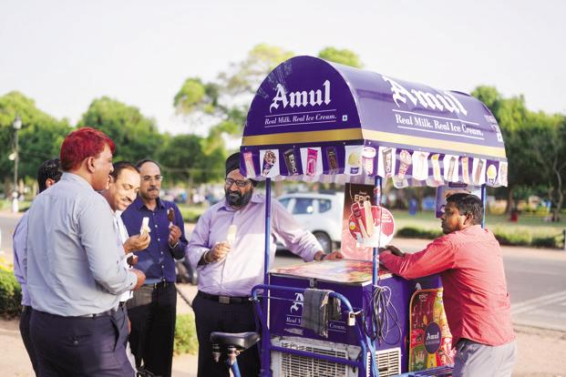 HUL and GCMMF are currently fighting a legal battle in the Bombay high court over whether the latter's Amul ice-cream ads disparage HUL's Kwality Wall's frozen desserts made with vegetable fat. Photo: Pradeep Gaur/Mint