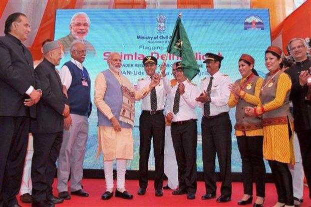 Prime Minister Narendra Modi (fourth from left) during the inauguration the UDAN regional connectivity scheme in Shimla. Photo: PTI