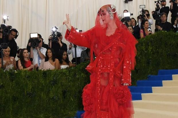 Pop singer Katy Perry, a co-chair of the ball, lived up to the theme's challenge with a custom Maison Margiela 'Artisanal' ensemble by John Galliano, an imperial red tulle dress and a veil embroidered with the word 'Witness'. AFP