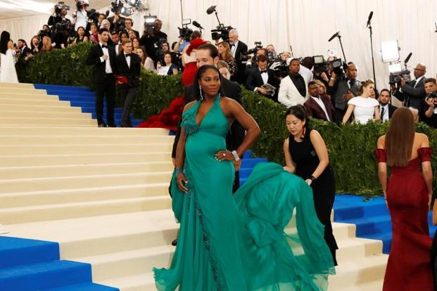 The pregnant Serena Williams was in bright green Versace. Reuters