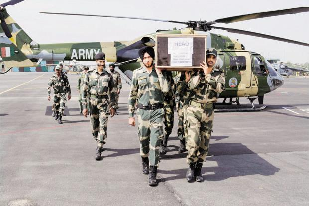 Jawans carry the coffin of the head constable killed in a ceasefire violation by Pakistan in Jammu on Tuesday