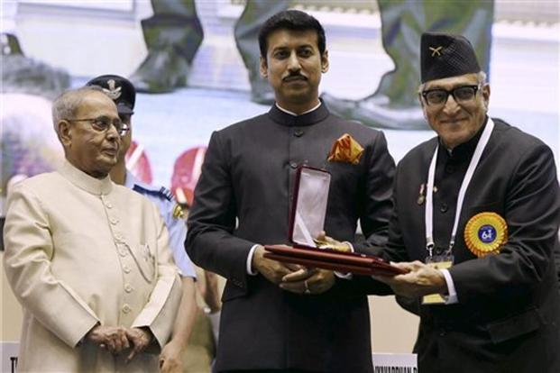 President Pranab Mukherjee presents an award to Mohan Agashe (right) for Best Feature Film for 'Kasaav'. PTI.