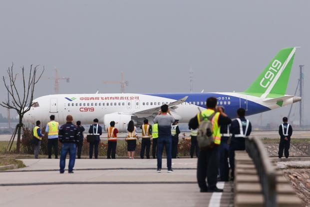 China's C919 passenger jet prepares to take off from Pudong International Airport in Shanghai on 5 May 2017. Photo: AFP