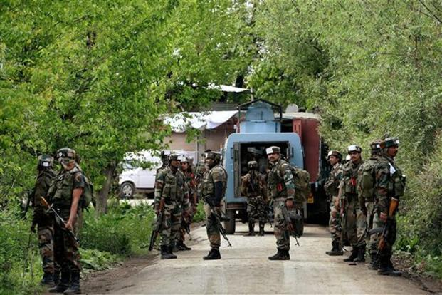 Army personnel take positions during a search operation at a village in Shopian district in south Kashmir on Thursday. Photo: S. Irfan/PTI