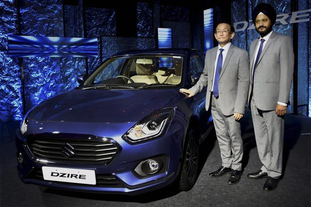 Maruti Suzuki MD Kenichi Ayukawa (left) and executive director (marketing and sales) R.S. Kalsi at the launch of the new Dzire car in New Delhi on Tuesday. Photo: PTI