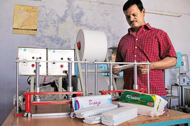 Padma Shri awardee Arunachalam Murugunantham shows his low-cost sanitary napkin making machine. Photo: HT
