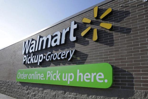 Wal-Mart officials are also striving to improve consumers' brick-and-mortar experience by focussing on cleaner aisles, faster checkouts and fewer missing items. Photo: Danny Johnston/AP