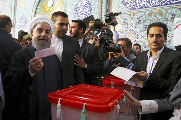 President Hassan Rouhani holds his ballot while voting for the presidential councils election at a polling station in Tehran, Iran on 19 May. Photo: AP