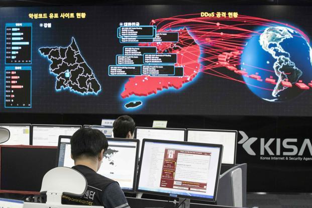 Staff monitoring the spread of ransomware attacks at the Korea Internet and Security Agency in Seoul on Monday. Photo: Yonhap/AFP