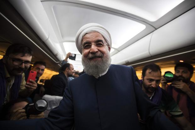 The strong popular mandate Hassan Rouhani received is severely limited, both at home and abroad. Photo: Behrouz Mehri/AFP