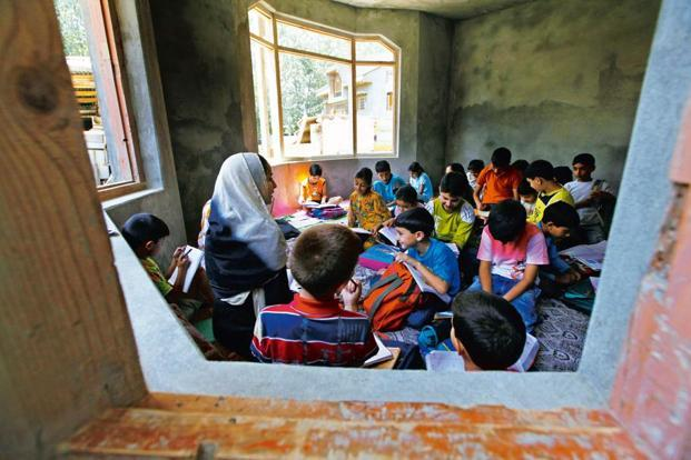 A file photo of a makeshift classroom in Srinagar. Furkan Latif Khan has collected over 1,000 books, mostly in English, from across the country for Karvaan. Photo: Reuters