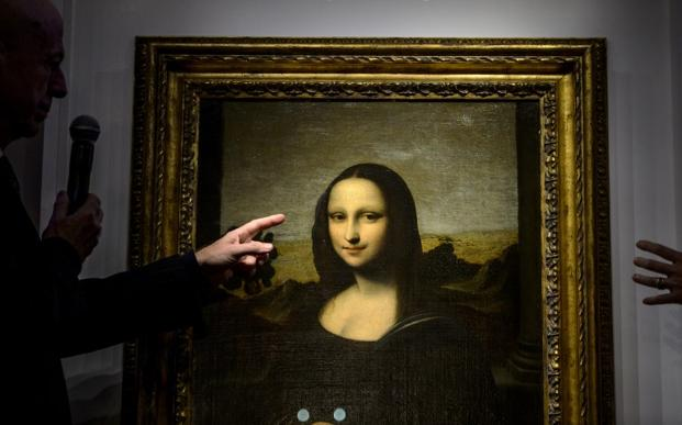 The identity of the mother of artistic genius Leonardo da Vinci, who painted the Mona Lisa (in pic), has remained elusive for nearly five centuries. Photo: AFP/Fabrice Coffrini