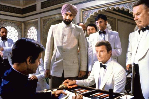 Kabir Bedi (standing) and Roger Moore in a still from 'Octopussy'.