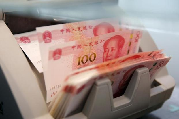 China dismisses credit downgrade