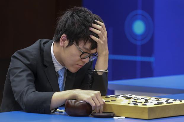 Chinese Go player Ke Jie reacts as he plays a match against Google's artificial intelligence program, AlphaGo, during the Future of Go Summit in Wuzhen in eastern China's Zhejiang Province on 25 May 2017.  Photo: AP