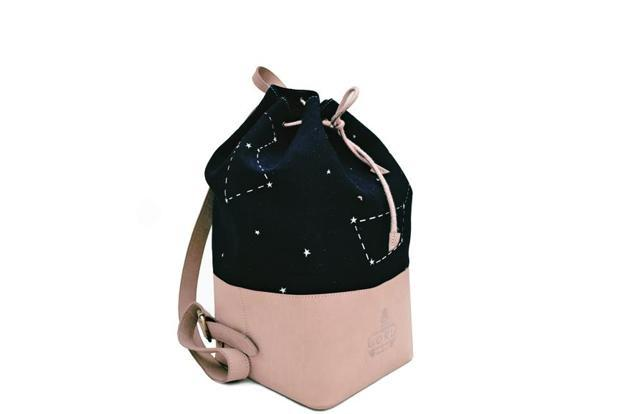 The Apostle Backpack by Cord studio is made in a leather and cotton canvas mix with a constellation print and a drawstring tie-up. At www.cordstudio.in; Rs5,200.