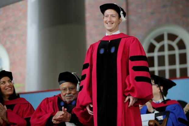 Facebook founder Mark Zuckerberg stands to receive an honorary Doctor of Laws degree during the 366th commencement exercises at Harvard University in Cambridge on Thursday. Photo: Reuters