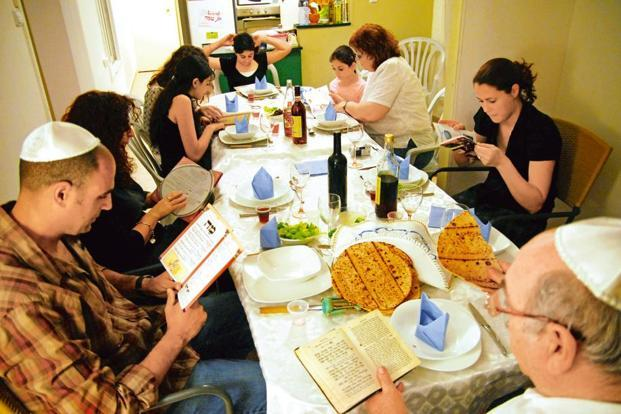The 'Seder' ceremony follows a set of steps, like reciting blessings, drinking from the ritual wine cup and telling stories of the Exodus. The 'Haggadah' guides participants through the ceremony. Photo: Alamy.