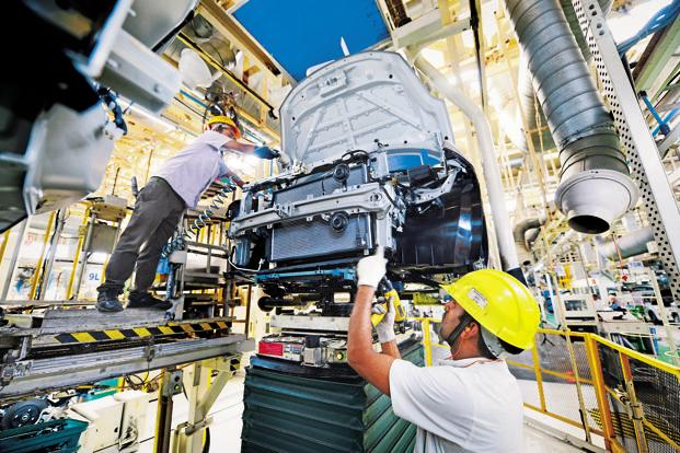 New IIP series will be used to estimate growth in industrial sector while new WPI series will be used as the deflator for the economic data to be released Wednesday. Photo: Ramesh Pathania/Mint